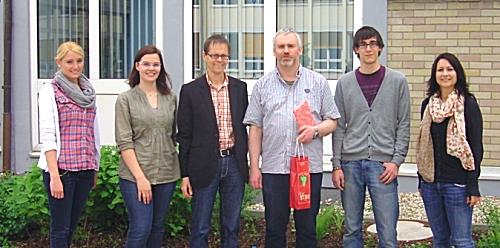 Prof. Scheuchenpflug mit Team und OStR Robert Glöckl